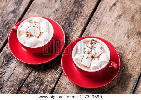 Cocoa With Marshmallow In Red Cups On The Table
