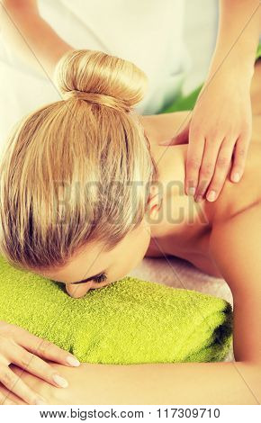 Young woman has massage.