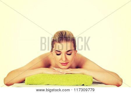 Young relaxed woman in spa.