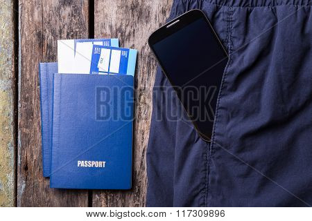 Smartphone In Pocket Of Trousers And Passports