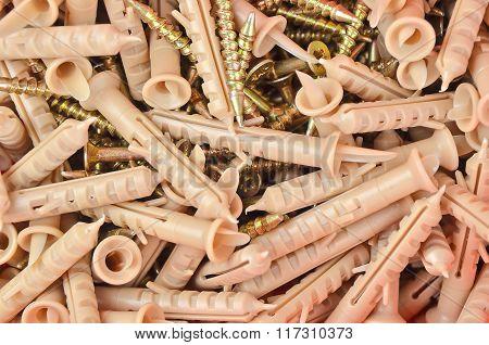 Screw and plastic dowel