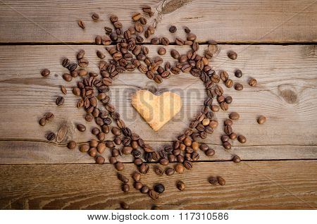 Frame- Heart From Coffee Beans And Cookies-heart  Inside It On  Wooden Table