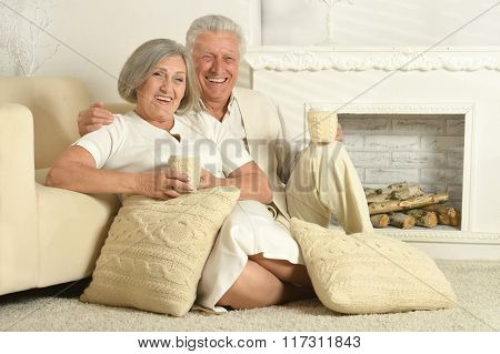 Elderly people with tea