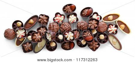 Delicious chocolate candies on white background