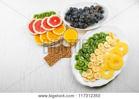 Fruits on light wooden background. healthy eating concept.