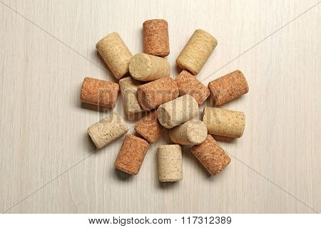 Wine corks on light wooden background