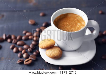 Cup of coffee on wooden table background