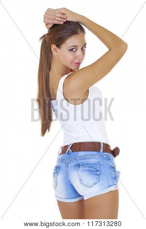 Beautiful cheerful teen girl in jean shorts, isolated on white background