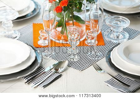 Served table with flowers in restaurant, closeup