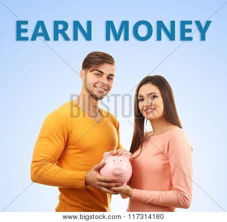 Couple piggy bank and banknotes on blue background