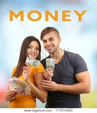 Couple with money banknotes on bright background