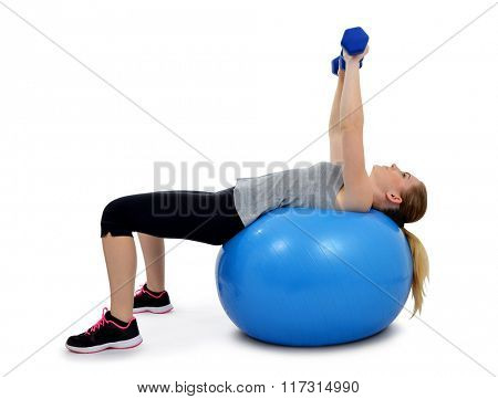 Girl exercising workout fitness aerobic on ball exercise pecs
