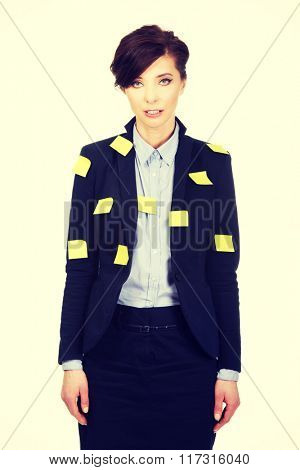 Businesswoman with adhesive cards.