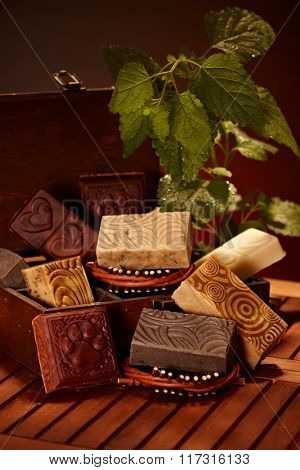 Aesthetic natural soap bars in wooden box.