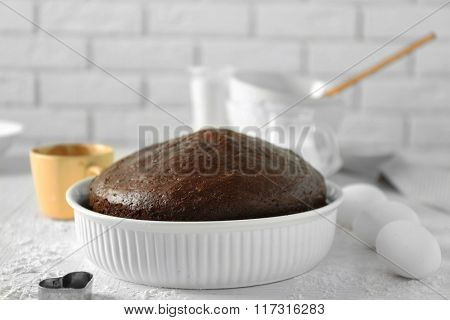 Cooked chocolate pie in a baking tray on a table