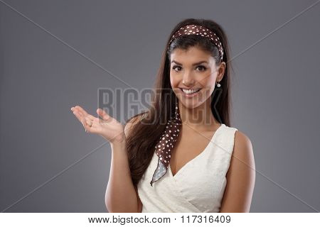 Young woman smiling happy, gesturing with hand.