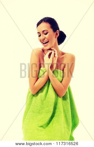 Happy woman wrapped in towel