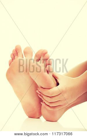 Woman touching her foot.