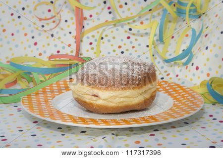 Germany carnival donut on a plate with carnival decoration