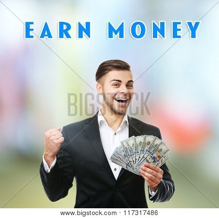 Man holding money on bright background