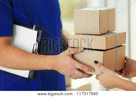Delivery concept. Receiving package. Close up