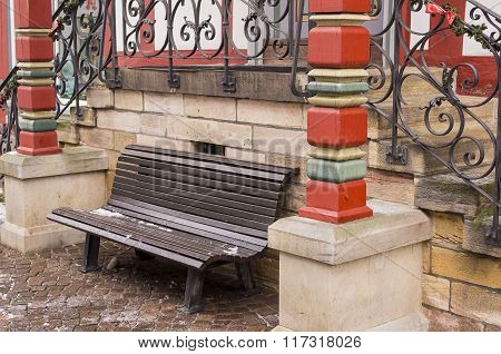 Bench near the porch.