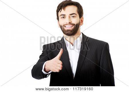 Businessman offering a handshake.