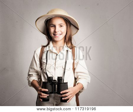 little explorer holding binoculars on a gray background