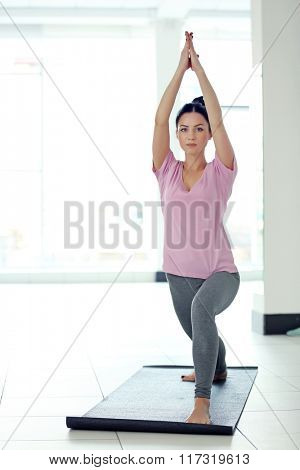 Beautiful healthy woman does yoga exercises in the gym, close up