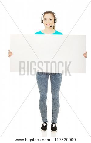 Call center woman with billboard.