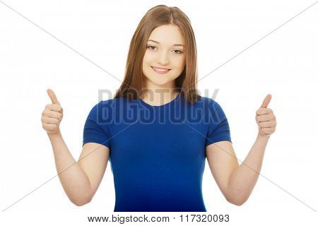 Happy female student showing thumbs up.