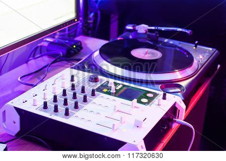 Dj vinyl player and mixer in studio