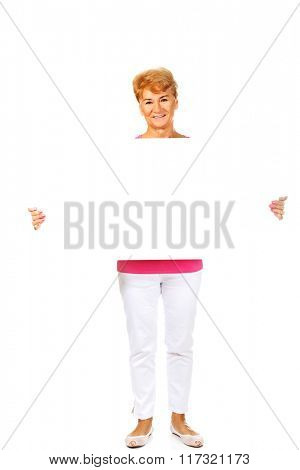 Smiling senior woman holding empty banner