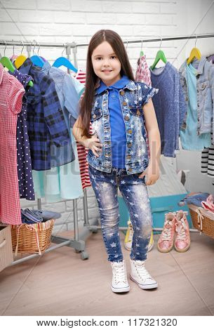 Little girl trying out a new jeans sit