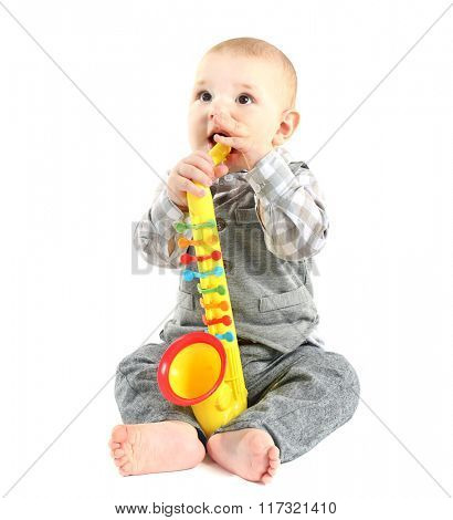 Adorable baby with plastic colourful saxophone isolated on white background