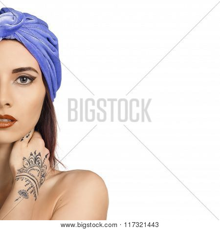 beautiful stylish woman in oriental style with mehendi wearing in turban