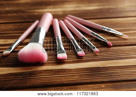Makeup Brush Set On A Brown Wooden Background
