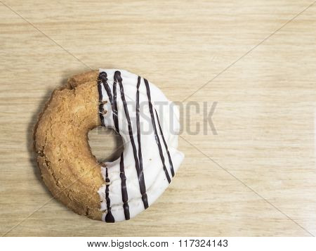 Donut On The Wood Texture With A Light Color
