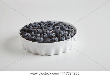 Heap Of Ripe Blueberries In Ceramic Bowl