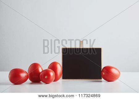 Heap Of Red Tomatoes With Price Tag Isolated