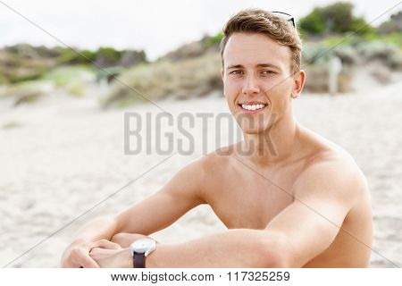 Handsome man posing at beach