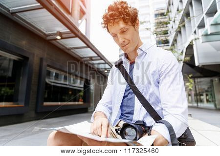 Male tourist in city
