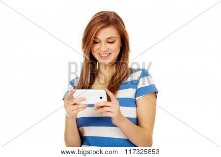 Teenage woman using mobile phone
