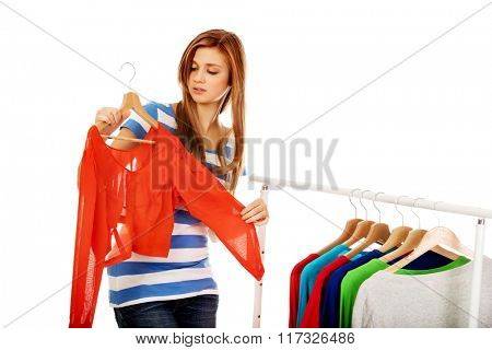 Teenage woman thinking what to dress