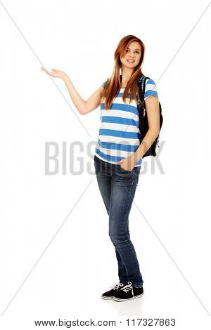 Teenage woman showing something on open palm