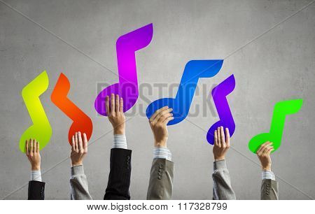 Music notes in hands