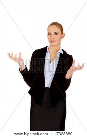 Angry business woman with hands up