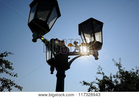 Outdoor Triple Lamppost With Dinosaur Silhouette