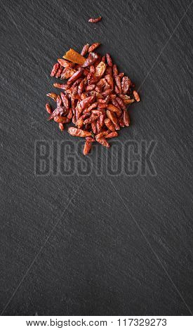 Cayenne Pepperl On A Black Slate Table