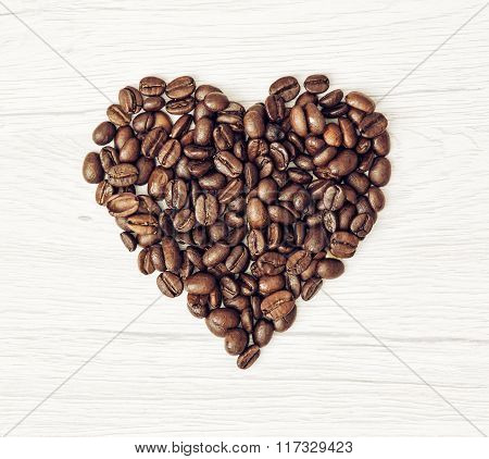 Shape Heart Of The Coffee Beans On The Wooden Background, Valentine's Day